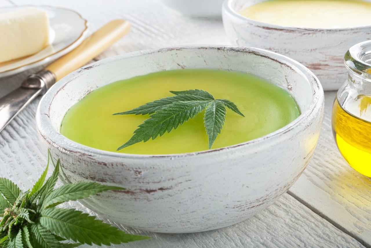 Marijuana leaf floating in Cannabis infused oil